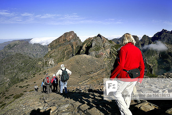 Hikers descend from Pico do Areeiro mountain peak in Madeira  Portugal