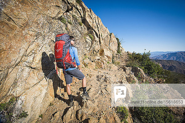 Young Man Standing On Pacific Crest Trail Near Mount Laguna  California  Usa