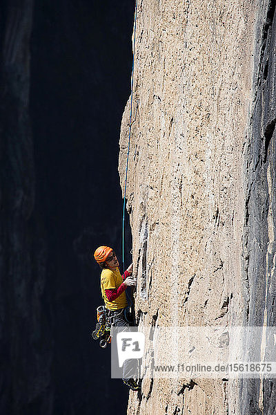 A man climbs to the top of one of the big wall routes in Basaseachic waterfalls in Chihuahua  Mexico