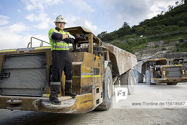 Portrait of a specialized underground truck operator at a mine. These vehicles are designed to navigate the mine shafts.