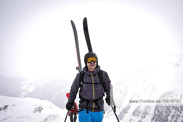 Smiling Skier Standing On Top Of Silverton Mountain In Colorado  Usa
