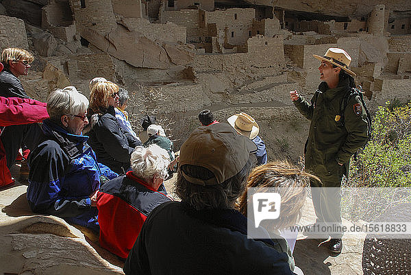 A Park Ranger gives a cultural tour to visitors at Mesa Verde National Park  a native merican site knowen for it's expansive cliff dwellings  in Southwest Colorado.
