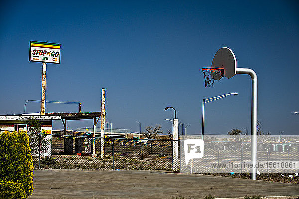 A deserted basketball court and gas station in Arizona.