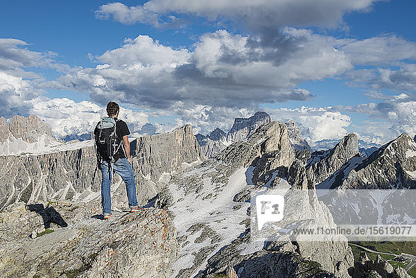 A Man Standing At The Top Of Nuvolau In The Dolomites  Italy