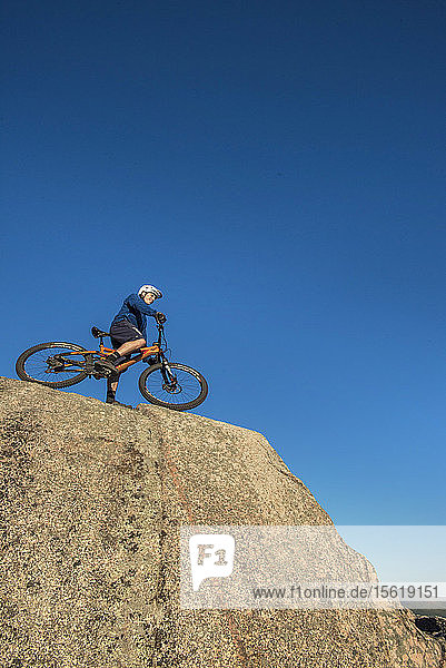 Low Angle View Of Alex Leich With Mountain Bike On The Bare Granite Slabs In North Conway  New Hampshire