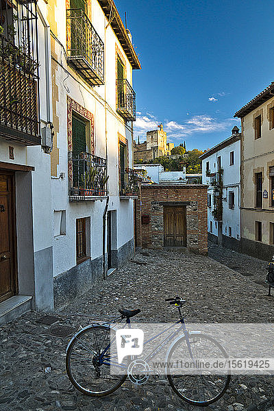 A bicycle stands alone in a picturesque square in Granada  Spain.