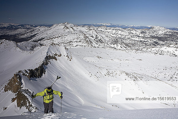 Male Skier Hiking On Snowy Region Near Lake Tahoe In California  Use