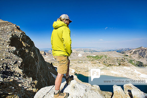 Male Hiker On Top Of Rock Exploring Grand Teton National Park