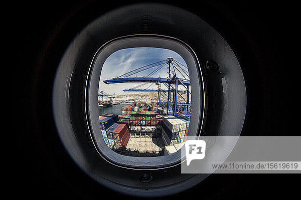 Watching a container ship being loaded from a window on one of the living quarters decks.