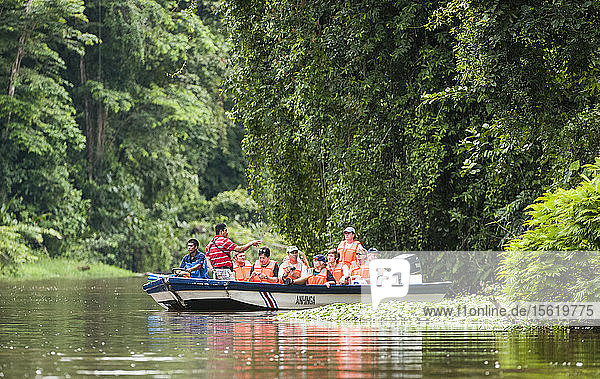 Tourists exploring the canals of Tortugaro National Park by boat  Costa Rica