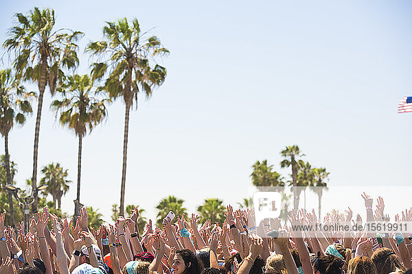 Close up of people hands celebrating during outdoor yoga festival in Santa Monica  California  USA