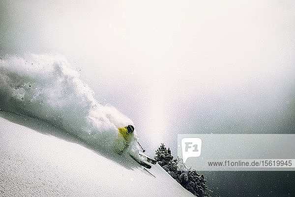 A man skiing powder at Snowbird  Utah