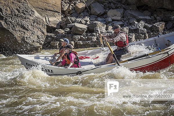 Man and two women sailing through rapids of Green River in Desolation Canyon  Utah  USA