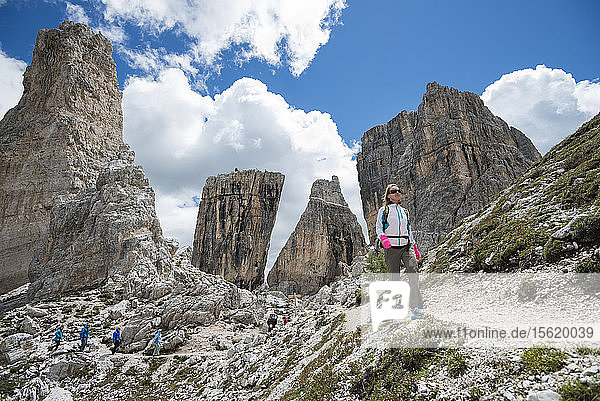 A Woman Hiking In Cinque Torri Area At Dolomites  Italy