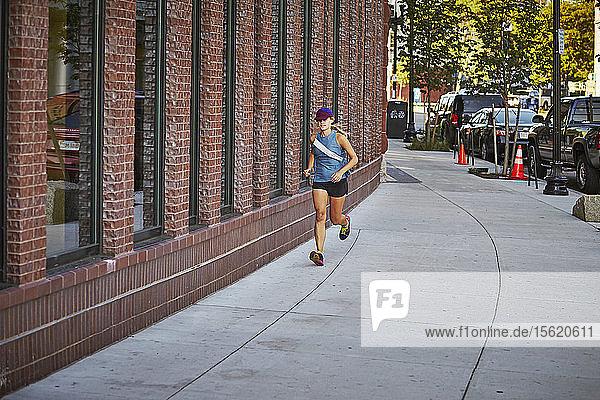 Female Runner Jogging On Street Of Boston
