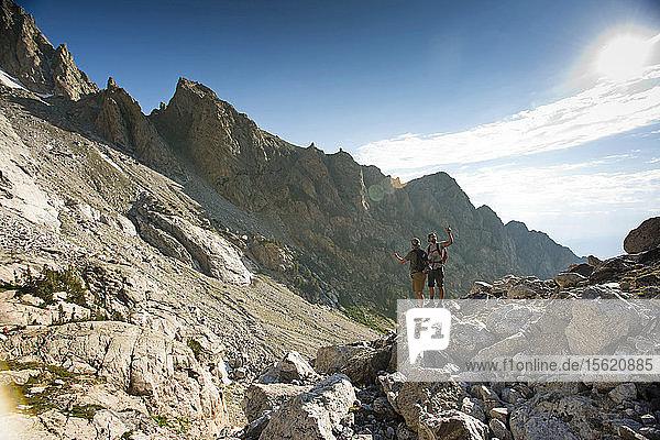 Two Hikers Stop To Find A Route In Grand Teton National Park