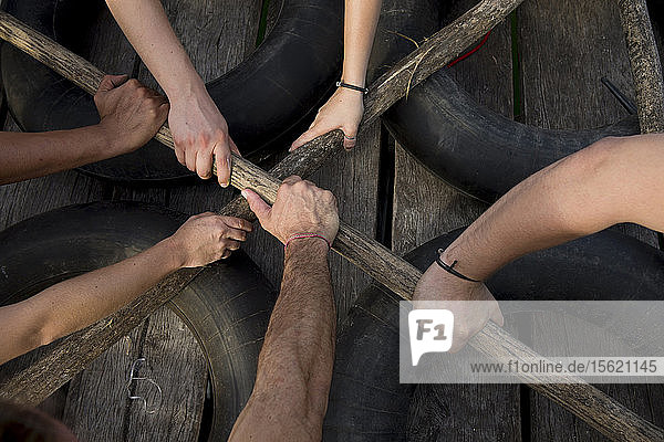 Group of people enjoying team building activities at lagoon of Pacchen near Cob  in Quintana Roo  Mexico