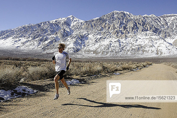 Ryan Hall  in white shirt  trains for the Olympics with Mike McKeeman  middle  and Steve Slattery  at the base of the Eastern Sierra mountains outside the town of Bishop  California about 30 miles from Mammoth Lakes. The high altitude and clean air provide a picturesque and challenging training ground for the Olympic hopeful.