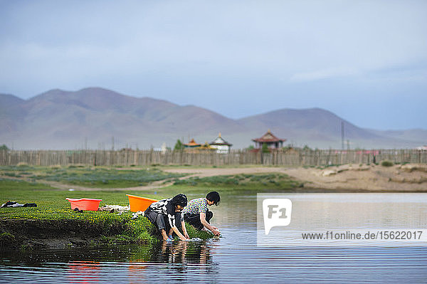 Two Woman Washing Their Wool In The River  Mongolia
