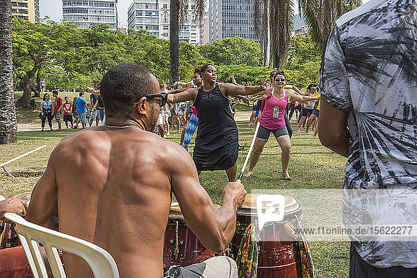 People dancing outdoors in open Afro Dance session in Aterro do Flamengo  Rio de Janeiro  Brazil
