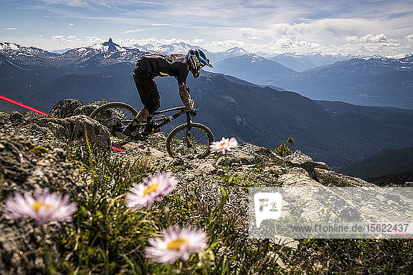 A Mountain Biker Riding On Rocky Landscape In Whistler  British Columbia  Usa
