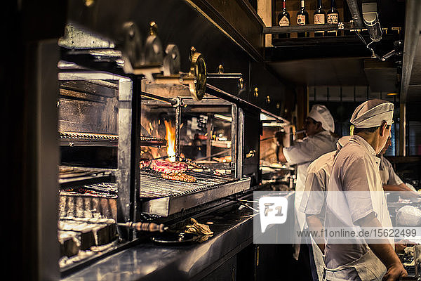 View of interior of restaurant with chefs in Buenos Aires  Argentina