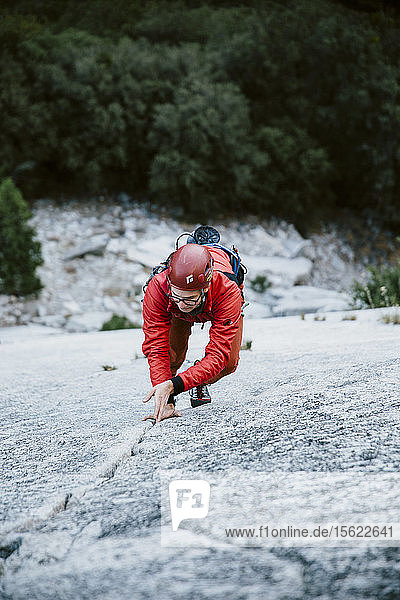 A man leading Pitch 1 on The Grack (5.6) in Yosemite Valley.