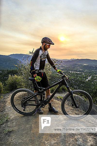 Male mountain biker in scenic landscape enjoying view  Durango  USA