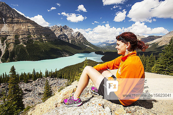 A Portuguese lady sat overlooking the stunningly beautiful Peyto Lake in the Canadian Rockies.