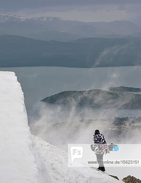 A Snowboarder On Snowy Landscape At Cerro Catedral In Argentina