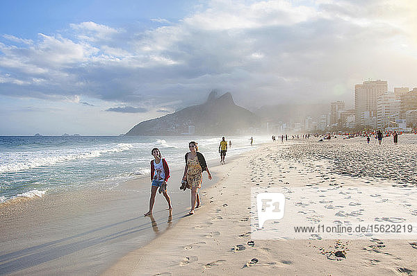 Two Young Women Walking On Ipanema Beach  Rio De Janeiro