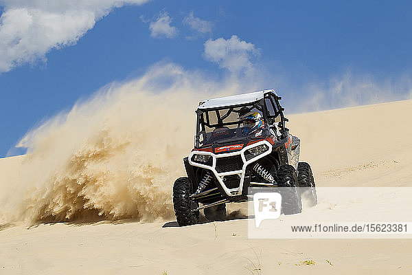 An amateur riders enjoys the dunes of Samalayuca  near Ciudad Juarez  Chihuahua