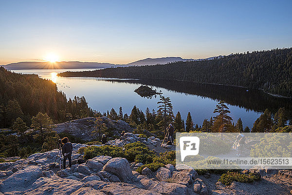 Group of photographers taking pictures of sunrise at Emerald Bay in Lake Tahoe  California  USA