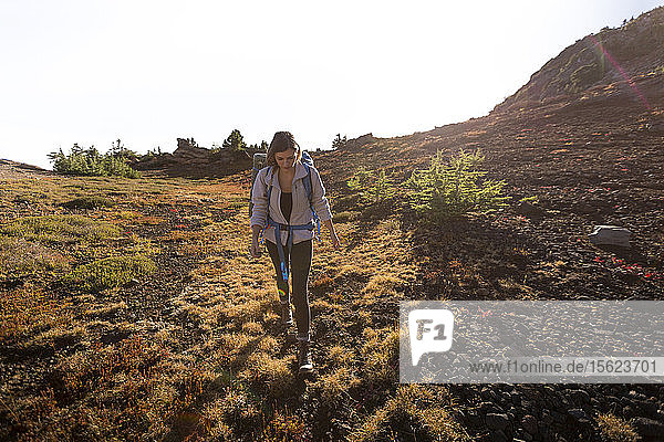 Female hiker hiking through the Mount Jefferson Wilderness