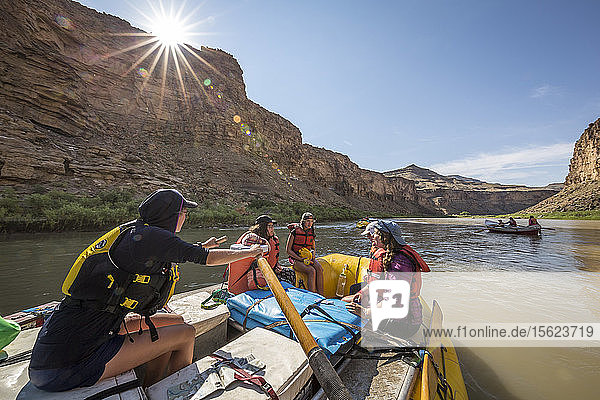Raft guide woman with three other women passengers on raft  Desolation/Gray Canyon section  Utah  USA