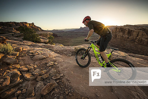 A man mountain biking on the Hymasa trail  Moab  Utah.