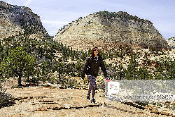 Photograph of female hiker exploring Zion National Park  Utah  USA