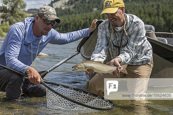 Two Fishermen Releases A Bull Trout In Montana's Kootenai River