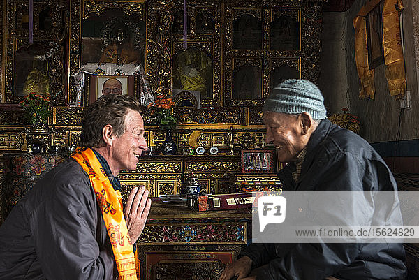 A Former Mustang King Jigme Palbar Bista Giving Blessing To A Photographer Thomas Kelly At His House In Lo Manthang  Mustang  Nepal