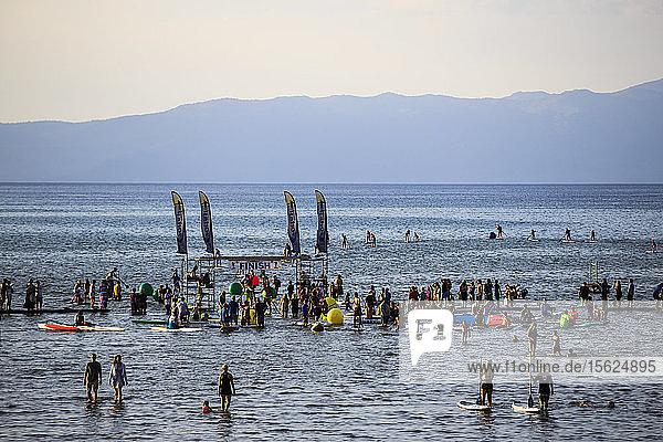 People gathering at the SUP racing series at El Dorado beach in South Lake Tahoe.