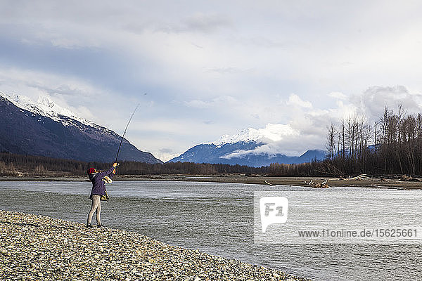 Professional Snowboarder Helen Schettini  fishes on the Chilkat River on a down day from snowboarding while on a trip to Haines  Alaska.