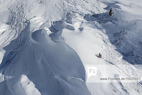 Professional Snowboarder Robin Van Gyn  rides fresh powder on a sunny day while snowboarding in Haines  Alaska.