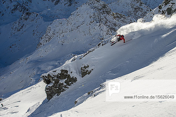 Skiers Yann Rausis and Theo Cheli skiing on powder day in Verbier  Valais  Switzerland