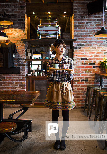 A barista at a coffee shop in Vancouver  BC  Canada.