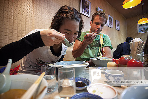 Young woman and man eating ramen noodles  Showa  Yamanashi Prefecture  Japan
