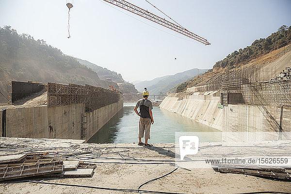 Robert Hahn contemplates the fate of the Nam Ou River in Laos as it flows through a concrete diversion (box) dam at Dam #5.