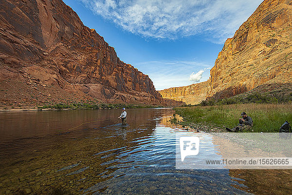 Man Fishing On The Colorado River In The Grand Canyon