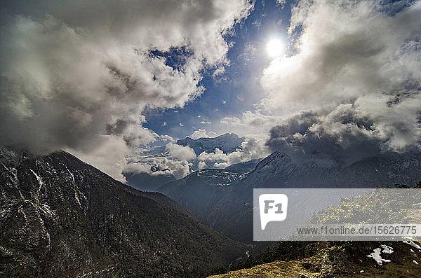 Sun shining between clouds over scenic landscape of Khumbu valley  Solukhumbu  Nepal