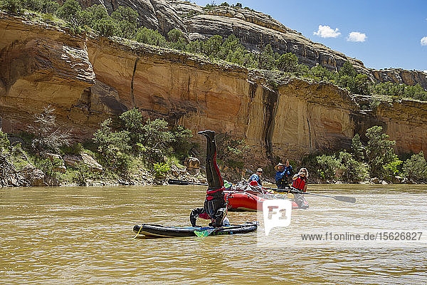 Man Does a Headstand During A Rafting Trip On The Yampa And Green Rivers
