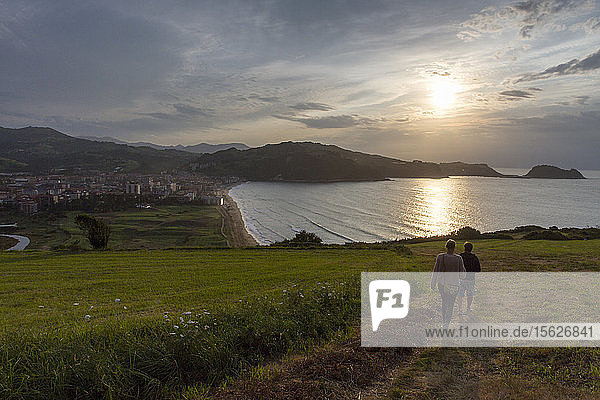 A couple go to the beach at sunset in Zarautz  Basque country (Spain).